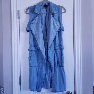 Denim No Sleeve Duster Cardigan. Light Denim Blue